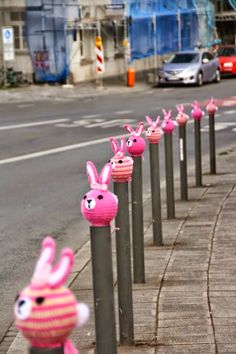 Nürnberger bunny tradition cool rabbit yarn bombing, guerilla knit community public art but is it cruelty to knitted animals to behead them and stick the head on a stake , cool gothic style funny yet macabre public space art photo that would make a smart easter card picture