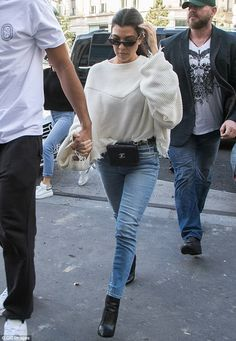Toned: Kourtney flashed her toned legs in skinny jeans and stiletto heel ankle boots...