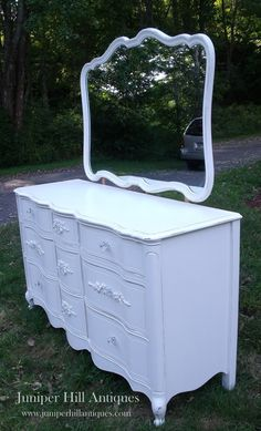 French Provincial long chest with roses and mirror.