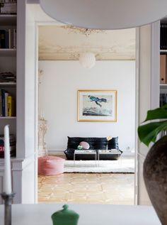 Black togo sofa and pink ottoman