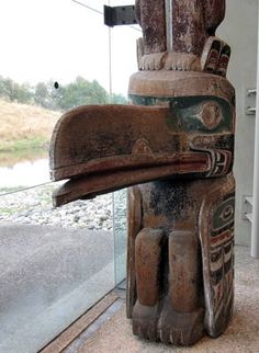 Raven from the Pole of Tatentsit. which was erected for, or by, T'at'entsit on the occasion of a large potlatch. The pole was re-adzed and re-painted by Kwakwaka'wakw carver Mungo Martin before shipping in 1947. At Museum of Anthropology, UBC