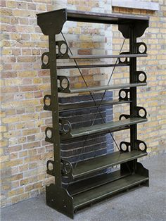 elemental Antique Shelving Unit  Salvaged from Manchester Central Library. Robust and solid utilitarian design. Adjustable shelves. origin: Manchester, UK   year: 1910 dimensions: width: 116cm; height: 196cm; depth: 45cm