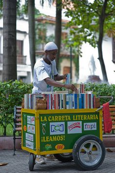 The Literary Cart.  As a young man Martin sold sodas and water in the streets of Cartagena.  He was a voracious reader though and began to carry books as well for exchange and to encourage other readers.  Now he has a full time mobile bookstore with sponsorships.    One of the great stories about Martin is that he does readings for young children from an elaborately bound book - filled with blank pages.  He makes the stories up as he goes along.