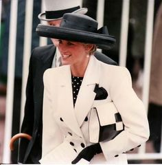 Princess Diana at Royal Ascot in June 1991 wearing a double breasted suit by Catherine Walker & a black hat by Philip Somerville.