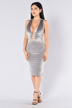 Available in Burgundy and Silver Velvet Midi Dress Sleeveless Deep V Neckline Cut Out Sides Strap Side and Chest Design Lined Made in USA 90% Polyester 10% Spandex