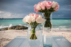 Gorgeous pale roses contrast beautifully with the bright teal waters. #DreamsSandsCancun #Mexico #Destinationwedding