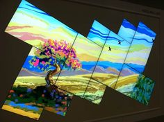 Samsung comprised this video wall with its UD22B and UD46C models. After tiling the rectangular and square-shaped screens, the finished product is museum video wall art.