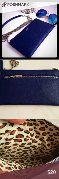 Sorial Wallet on Chain in Sapphire blue Brand new never used.  Great size to take only the necessities. .Sapphire blue Vegan Leather with zip closure. Zip pocket on back side. Leopard print interior. Silver chain with padded part on top for comfort. sorial Bags Crossbody Bags