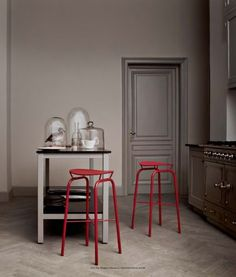 Traditional kitchen, red stools, glass display, LaCornue stove