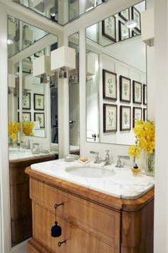 Sophisticated Powder Room    An antique Biedermier chest and mirror panels add a dramatic feel to this small space.      This compact powder room has big impact, matching the formal style of the rest of the apartment. A series of botanical prints are a nice choice in this traditional room.