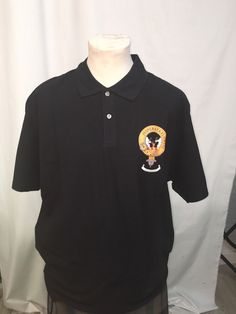 Cotton polo shirt with printed Watson clan crest. Black, x large. Clearance item. only one available at this price - half the normal selling price