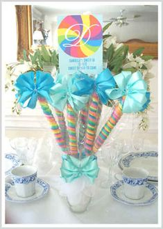 What a simple but elegant centerpiece. Rainbow lollipops heck ya