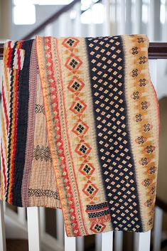 blanket made from vintage saris hand-stitched in bangledesh using a traditional kantha stitch.