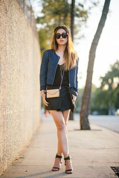 Jenny Ong is wearing a denim mesh jacket from Cynthia Rowley, black cami by J. Brand, black skirt by Isabel Marant, purse by Rebecca Minkoff...