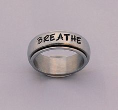 """I got this spinner ring for Rachel - containing part of a quote she likes, """"And we will be the stars we were always meant to be."""". Spinner Ring- Personalized Stainless Steel Spinner Ring"""