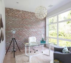 A simple and urbane way to bring in contrast into the home office with brick wall - Decoist