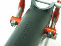 POP-Products UD Carbon Sattelstützen Kopf der 34,9x425 mm Sattelstütze. Set up in Orange und Logo in Schwarz