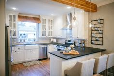 Fixer Upper Season 2  Chip and Joanna Gaines Renovation   The Dutch Door House   Kitchen Remodel   Dark countertops   Wooden Beams