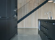 Part of the Danish, family-run design firm Vipp, CEO Kasper Egelund lives a stone's throw from Copenhagen with his wife Heidi and their three children. Interior Design Studio, Interior Styling, The Way Home, Home And Family, Kitchen Under Stairs, Sofa Next, Black Kitchen Island, Mim Design, New York Architecture