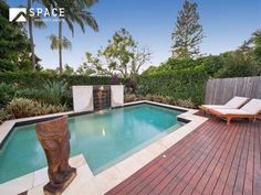 Landscaped pool design using brick with pool fence & outdoor furniture setting - Pool photo 273055
