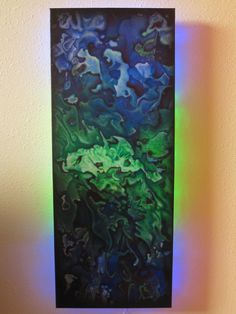 """""""Under the Sea""""   abstract with hidden sea-horse in the middle....   with green and blue led back lighting"""
