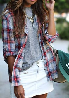 Gray tee, red/white blue plaid shirt, white jeans instead of skirt