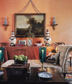 An orange painted library decorated by Mario Buatta. Architectural Digest; photo by Scott Frances.