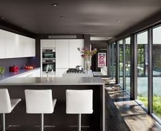 Floor To Ceiling Windows: A New Way To Define Your Home. A bit too modern of a kitchen for me but I do love the floors and wall of windows.
