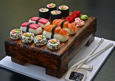 Sushi Cake! Wooden board made of cake and sushi made of fondant and other candy. Chopsticks and soy sauce made of fondant.