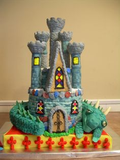 Dragon Dreams - This castle was created using, 10,8 & 6 inch double layer rounds, Wilton 11 x 15 sheet pan and the Wilton Romantic Castle Set. The dragon was created from the Wilton Horseshoe pan. All the decorations were created with butter cream and fondant. The best part was creating the dragon itself with all his many scales. He's a sleepy dragon day dreaming about the castle he protects while lounging on his favorite pillow. Thanks for looking.
