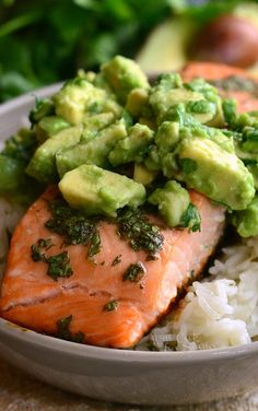 Beautiful honey, lime, and cilantro flavors come together is this tasty salmon rice bowl. Cilantro lime rice with honey, lime salmon and fresh avocado. Salmon Dishes, Fish Dishes, Seafood Dishes, Clean Eating Recipes, Healthy Eating, Cooking Recipes, Healthy Recipes, Healthy Hair, Fish Recipes