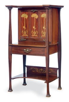 AN ENGLISH ARTS AND CRAFTS MAHOGANY AND MARQUETRY FALL-FRONT DESK,