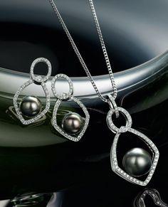 18k white gold pearl and diamond earrings, & 18k white gold pearl and diamond pendant