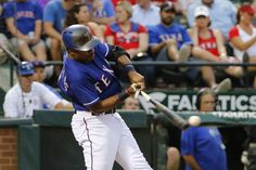 Texas Rangers left fielder Delino DeShields (7) hits a broken bat grounder in the third inning during the game against the Arizona Diamondbacks at Globe Life Park in Arlington, Texas on Wednesday, July, 8, 2015. (Michael Reaves/The Dallas Morning News)