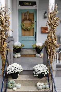 I recently showcased our fall porch and had several questions regarding what pumpkins I used, how I created the wreath, and what I used to attach the corn shocks to the columns. I thought I would shar