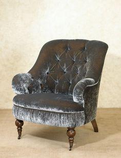 Slate gray velvet armchair.