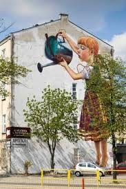 Białystok - mural - Dziewczynka konewką podlewa drzewko