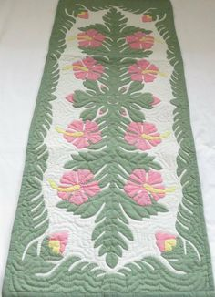Hawaiian quilt table runner 100% hand quilted/hand appliqued Hawaiiana by Hawaiian Quilts & Gifts. $59.95. It has 3 loops in the back where you can insert a rod for easy hanging. There's a count of 6-8 stitches in an inch. Multi Pink Hibiscus Design. 100% Hand Quilted and 100% Hand Appliqued. 100% Brand New Hawaiian Handmade Table Runner / Wall Hanging 20x50. ALOHA, this quilt is made of 65% Polyester and 35% Cotton. Which makes the quilt 100% machine washable. We hand-wa...