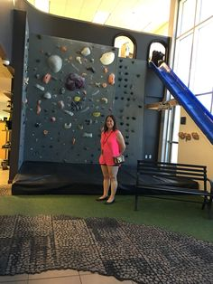 Suzie Solar at Goal Zero HQ in front of the rock climbing wall which she scaled after months of preparing.  That slide is fast!!