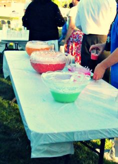 Easy, yummy wedding reception beverage! Lime, strawberry, and orange sherbet mixed with Sprite in punch bowls! It was a cool, refreshing beverage at our outdoor summer wedding reception. Plus the bright colors of the sherbet matched our wedding colors!