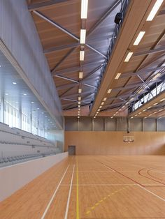 Image 7 of 36 from gallery of Guingamp / Agence d'Architecture Robert et Sur. Photograph by Stéphane Chalmeau Stadium Architecture, Timber Architecture, Education Architecture, School Architecture, Architecture Design, Hall Design, Gym Design, School Design, Indoor Basketball Court