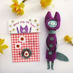 Funny little commission I did with the theme of cats and eggs. This is a little purple cat who's favourite food is fried eggs on toast.   . . . #cats #eggs #plush #plushie #plushies #etsyshop #etsyseller #etsyartist #makersmovement #makersvillage #craftsposure #handmadedoll #handmadetoys