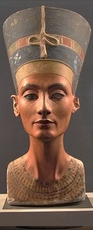 """Nefertiti - who was the chief wife of the Pharoah Akhenaten and was the step-mother of Tutankhamun. She ruled alongside Akhenaten during the eighteenth dynasty (1550-1292 BC). Nefertiti means, """"The beautiful one has arrived.""""  Tutankhamun's mother has been confirmed as Mummy KV35YL, (her name is unknown) a sister of Akhenaten. In c.1348 BC Ankhesenamun was born to Akhenaten and Nerfertiti, making her Tut's half-sister. At the age of ten Tut married her. He died at the age of 19."""