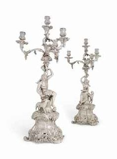 £100,000 A PAIR OF VICTORIAN SILVER FOUR-LIGHT CANDELABRA MARK OF ROBERT GARRARD, LONDON, 1837