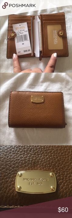 Michael Coors jet set Brown wallet This is a brand-new wallet Michael Coors brown color Michael Kors Bags Wallets