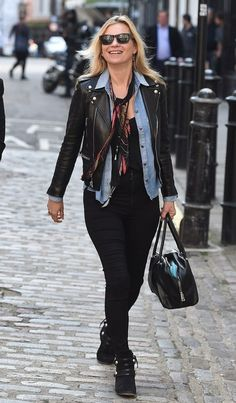 WHO: Kate Moss in London on April 28 2016  WHAT SHE WORE: Kate wore black leather Saint Laurent biker jacket, black skinny Topshop Joni jeans and black suede Isabel Marant ankle boots