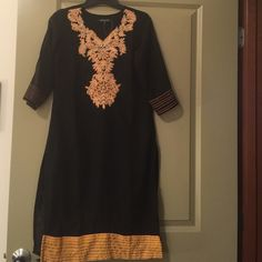 Authentic Kurti top black with yellow embroidery Gorgeous authentic black Kurti top dark yellow embroidery, orange stitching at sleeves. 3/4 sleeves. Long slits at sides. Fits size 0/2 US (chest/bust 34-36 inch, hips/waist 35-37 inch), Continental Indian size S(38). Regular height. Falls below knee for 5'1/5'2 petite girls or at/above knee for taller ladies. Fine georgette. Fully lined. Sheer sleeves. Brand new, never worn. Pair with black leggings or slim pants & heels for perfect unique…