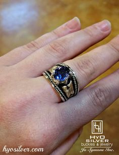 Pictures just don't do this ring justice! A bright & beautiful simulated Tanzanite stone is surrounded by yellow gold scrolls & accented by a sterling silver rope with a black antique background. SKU:R048-Tanzanite, $380. #hyosilver #musthave #rings