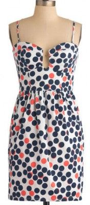White sun dress with navy & coral polka-dots.
