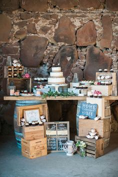 rustic barn cake table with vintage crates and barrels